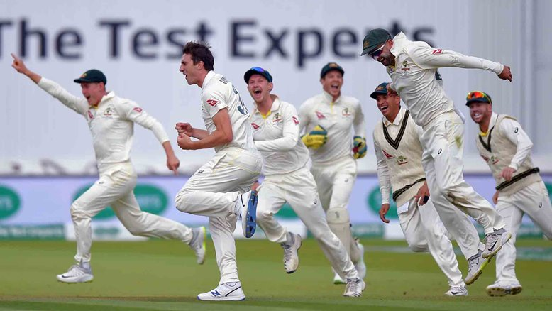 Australia celebrate a wicket at Lord's.