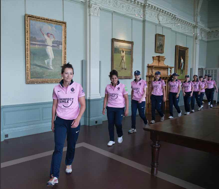 Natasha Miles leads her Middlesex team through the Long Room