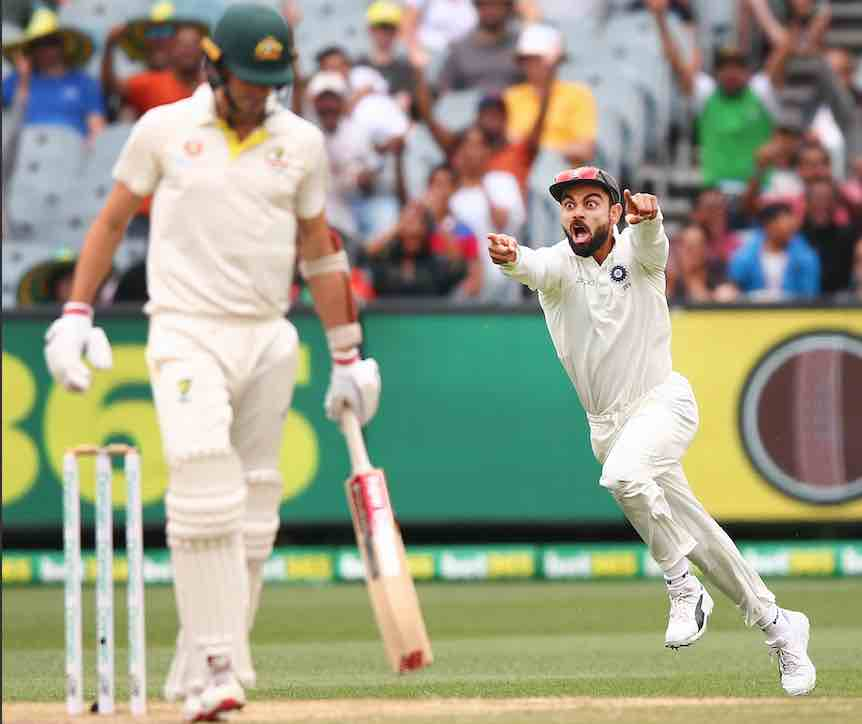 Virat Kohli enjoys the dismissal of Australia's Pat Cummins