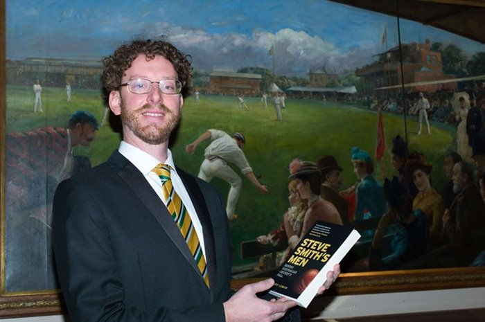 Geoff Lemon poses with his book, 2019.
