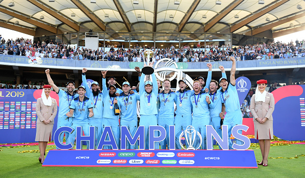 Eoin Morgan lifts the Cricket World Cup trophy in front of the Warner Stand
