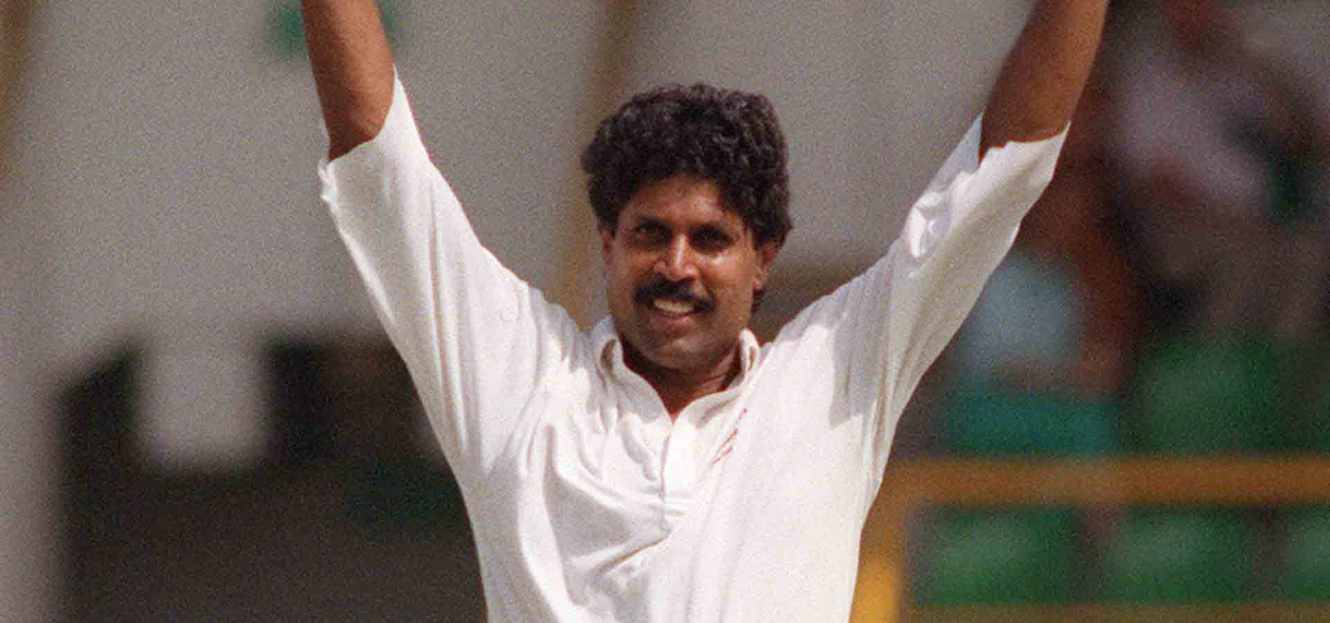 Kapil Dev celebrating a wicket.