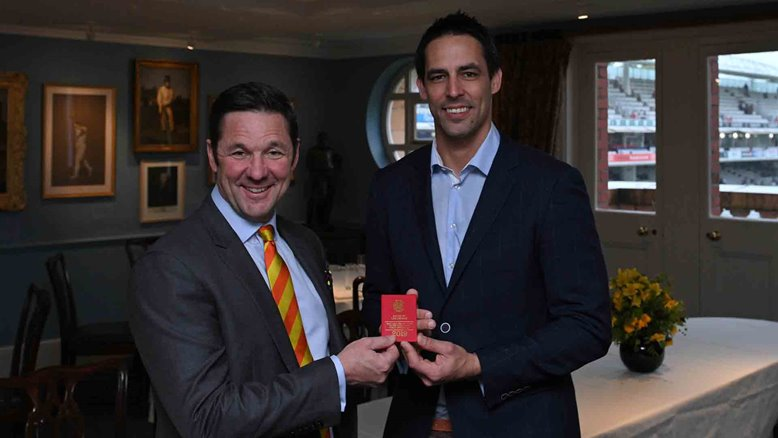 MCC Chief Executive Guy Lavender presents Mitchell Johnson with his MCC Honorary Life Membership