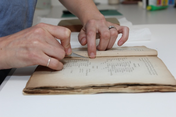 A book is rebound as part of MCC's conservation work